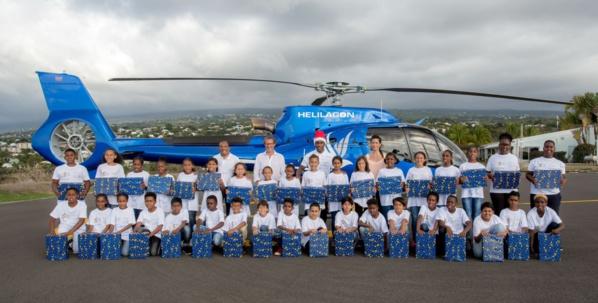 <center>Baptême en hélicoptère avec Hélilagon <br>Junior et Thierry Jardinot jouent les pères Noël <br> pour les marmailles de 1000 Sourires