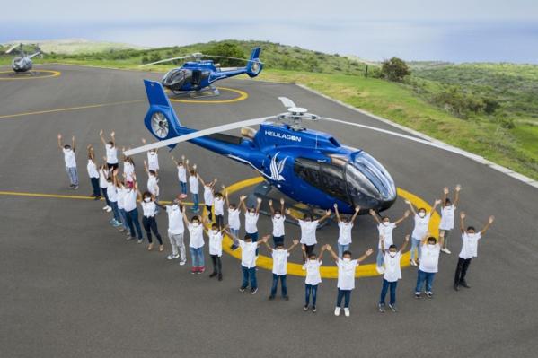 <center> Premier vol en hélicoptère avec Hélilagon<br> pour les marmailles de 1000 Sourires
